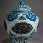 Carved blue-and-white underglaze red jar with lid from the Yuan Dynasty. Simple and vigorous in shape and bright in gradation of decorative patterns.