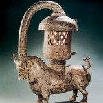 An Eastern Han dynasty copper ox lamp inlaid with silver